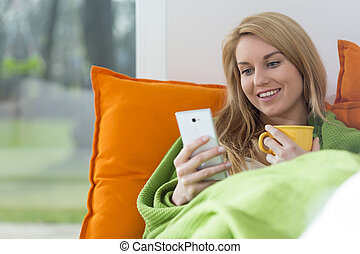 Beautiful woman with mobile phone - View of beautiful woman...