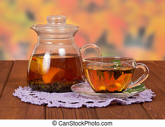 Teapot and a cup of tea on napkin