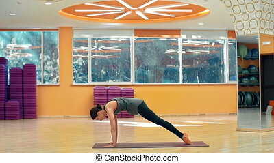 Body Awareness - Side view of pretty yogi performing...