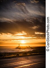 The Lighthouse Place. Lighthouse and the Sunset Scenery....