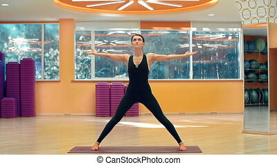Wide-Legged Standing Forward Bend - Front view of yoga...