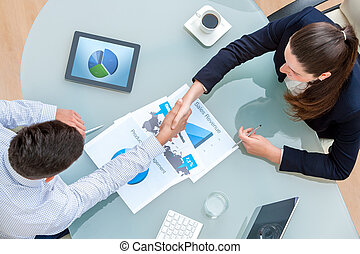 Business partners shaking hands on deal - Top view of young...