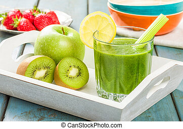 Green Smoothie on a tray with fresh fruits