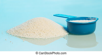 Washing powder and blue container on blue background