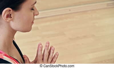 Lotus Pose - Tilt down the girl seated in lotus pose