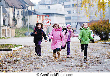 school girls running away - happy school girls running...