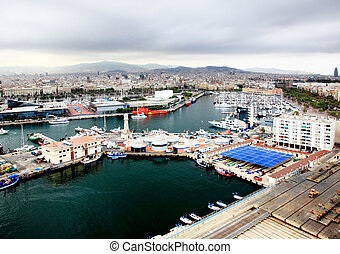 an aerial view of Barcelona City and harbor, Spain