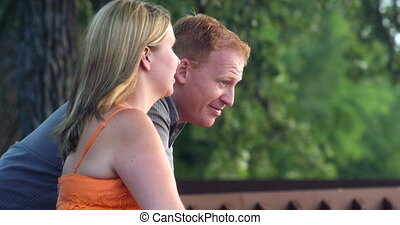 Young couple together in a park