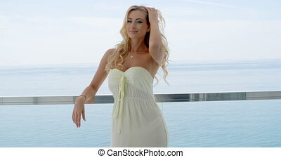 Blond Woman Standing on Ocean View Balcony - Smiling Blond...