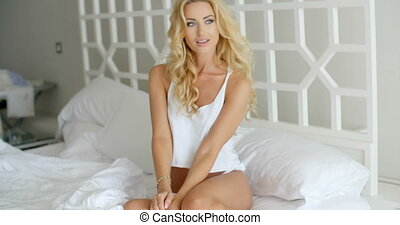 Sexy Woman Sits on Bed with Elbow on her Knee - Sexy Young...