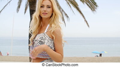 Blond Woman on Beach Smiling Over Shoulder - Smiling Blond...