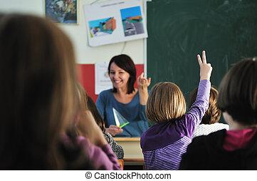 happy teacher in school classroom - happy young teacher...