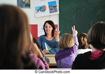 happy teacher in school classroom - happy young teacher...