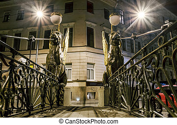 Griffins on Bank bridge across the griboyedov Canal in night...