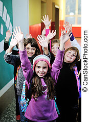 happy children group in school - happy childrens group in...