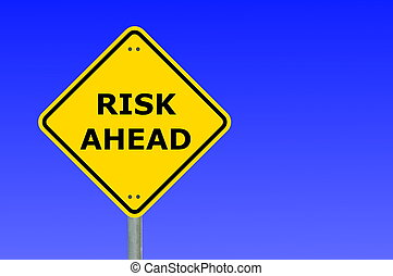 risk management concept with yellow road sign...