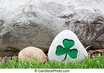 Decorative rock with a painted green shamrock - Decorative...