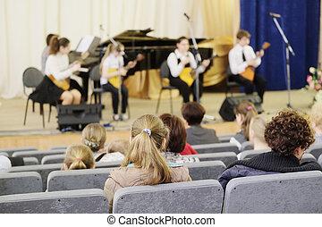 Spectators watch the concert