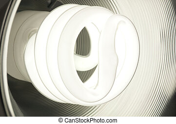 Compact Fluorescent Light Bulb Glowing - Energy saving...