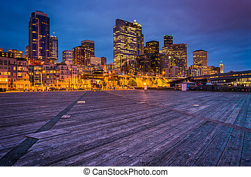 Pier 62 and buildings in downtown at twilight, in Seattle,...