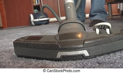 cleaning dirty carpet with vacuum cleaner