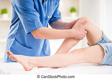 At doctor's - Close-up of male physiotherapist massaging the...