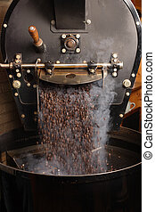 Roasting coffee beans - The freshly roasted coffee beans...