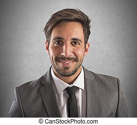 Confident businessman - Portrait of a businessman smiling...