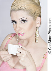 the girl in pink with a cup of coff