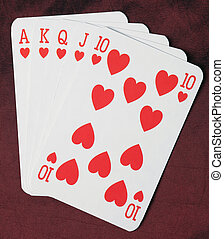 poker cards royal flush on red background