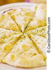 garlic bread - a delicious plate of flat garlic bread