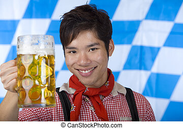 Happy man smiles and cheers with Oktoberfest beer stein (Mass)