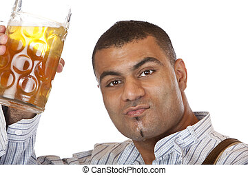 Young man holding full Oktoberfest beer stein in hand - Man...