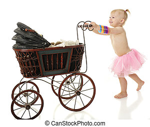 Baby Pushing Buggy - An adorable barefoot 2-year-old...