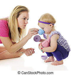 Take a Sip - Mother and daughter playing tea party. Mommy...