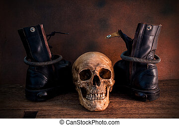 skull with combat boots still life