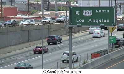 Los Angeles 101 Freeway Traffic - Vehicle traffic drives in...