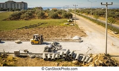 Time lapse of construction workers and small loader fixing the pavestone on the road. 4k