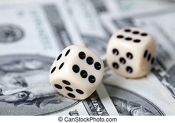 Dice on american money - the dice isolated on white...
