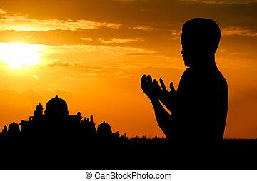 muslim boy - Silhouette muslim people  praying at sunset.