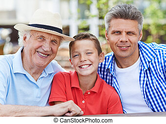 Handsome males - Happy senior man, his son and grandson...