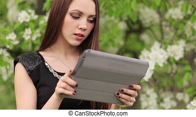 Young woman with digital tablet on