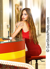 single woman in a bar - beautiful single woman in red dress...