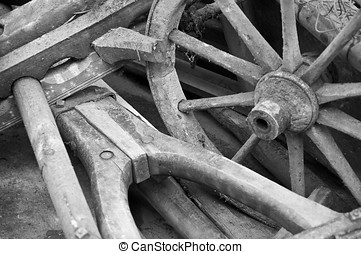Wagon wheel and yoke - Old wagon wheel and yoke in black and...