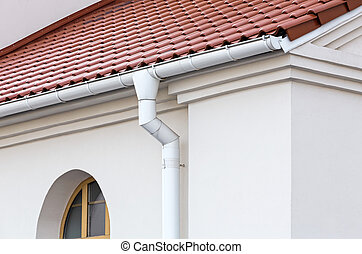 Roof details - Rain gutter and downspout on wall of house
