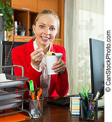 Lunch in office - Young blond woman in jacket having...