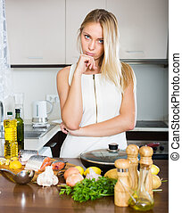 Housewife thinking what to cook for dinner - Blonde young...