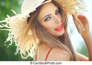 Summer Beauty - Young woman in straw hat smiling in summer...