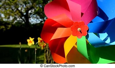 Colordul garden pinwheel - Tracking shot of the decorative...