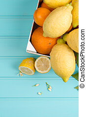 Citrus fresh fruits on wooden table background.